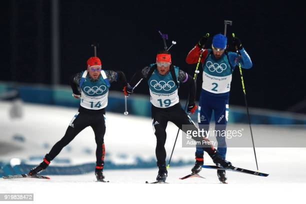 Erik Lesser of Germany competes with Martin Fourcade of France and Simon Schempp of Germany during the Men's 15km Mass Start Biathlon on day nine of...