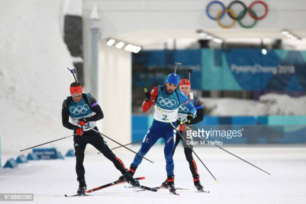 Erik Lesser of Germany Martin Fourcade of France and Simon Schempp of Germany compete during the Men's 15km Mass Start Biathlon on day nine of the...