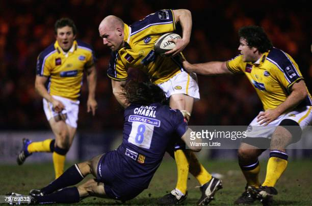 Erik Lund of Leeds is tackled by Sebastien Chabel of Sale during the Guinness Premiership match between Sale Sharks and Leeds Carnegie at Edgeley...