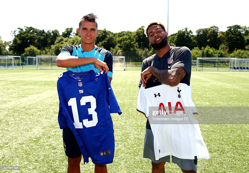 Erik Manuel Lamela (L) and New York Giants star Odell Beckham Jr. (R) at Tottenham Hotspur's Training Centre during an NFL promotional visit to London on July 19, 2016 in Enfield, England.