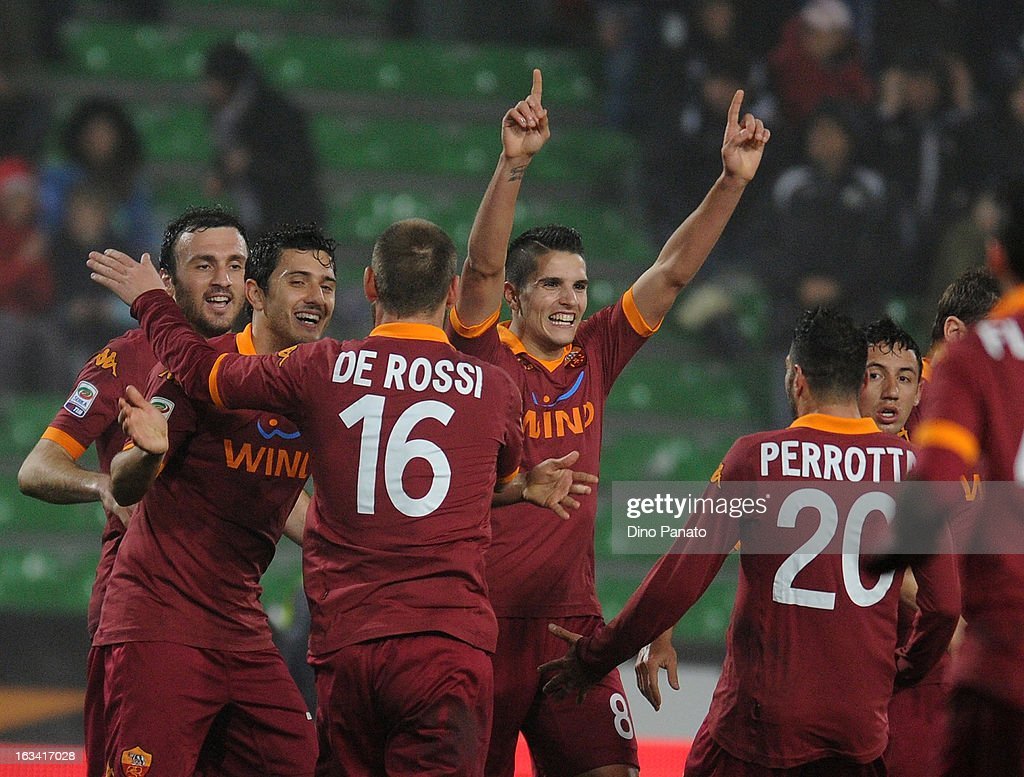 Erik Manuel Lamela (C) celebrates after scoring his opening goal during the Serie A match between Udinese Calcio and AS Roma at Stadio Friuli on March 9, 2013 in Udine, Italy.