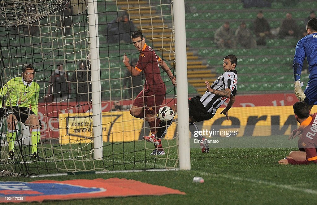 Erik Manuel Lamela (L) scores his opening goal during the Serie A match between Udinese Calcio and AS Roma at Stadio Friuli on March 9, 2013 in Udine, Italy.