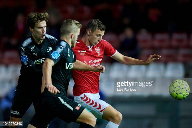 Erik Marxen of Randers FC Jonas Bager of Randers FC and Gustaf Nilsson of Vejle Boldklub compete for the ball duringthe Danish Superliga match...