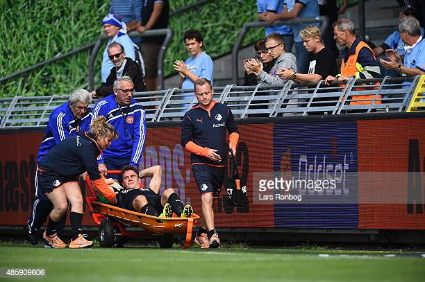 Erik Marxen of Randers FC leaves the pitch injured during the Danish Alka Superliga match between AaB Aalborg and Randers FC at Nordjyske Arena on...