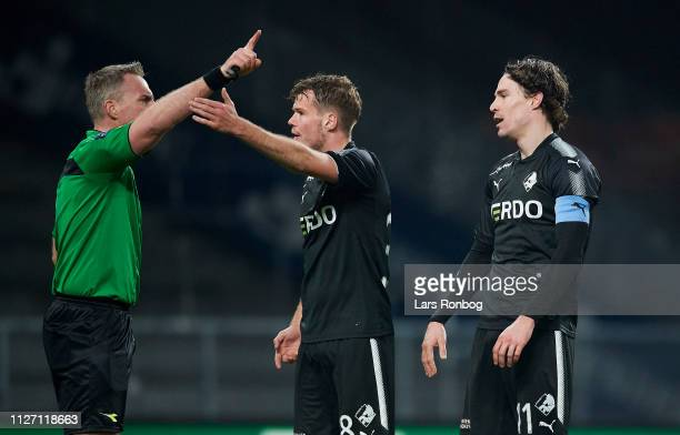 Erik Marxen of Randers FC receiving a red card from referee Jakob Kehlet who discusses with Nicolai Poulsen of Randers FC during the Danish Superliga...