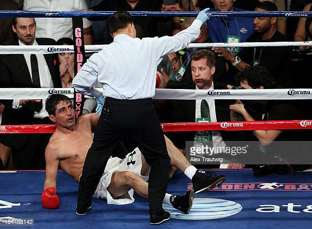 Erik Morales is knocked out by Danny Garcia in the fourth round of their WBA Super WBC Ring Magazine Super Lightweight title fight at the Barclays...