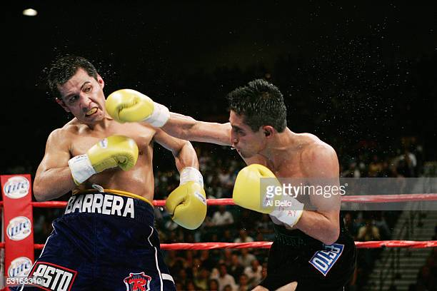 Erik Morales lands a right hand to the head of Marco Antonio Barrera during the WBC World Super Featherweight Championship at the MGM Grand Garden...