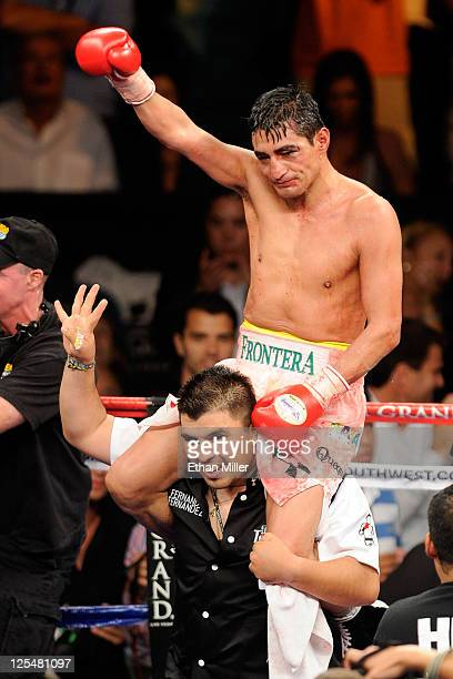 Erik Morales of Mexico celebrates his TKO victory against Pablo Cesar Cano of Mexico in their WBC super lightweight title fight at the MGM Grand...