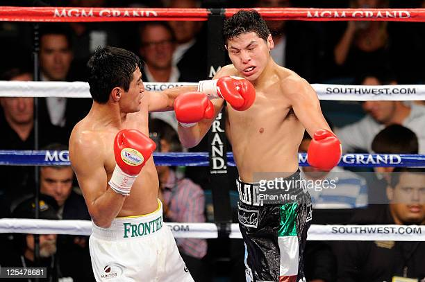 Erik Morales of Mexico connects with a left to the face of Pablo Cesar Cano of Mexico during their WBC super lightweight title fight at the MGM Grand...