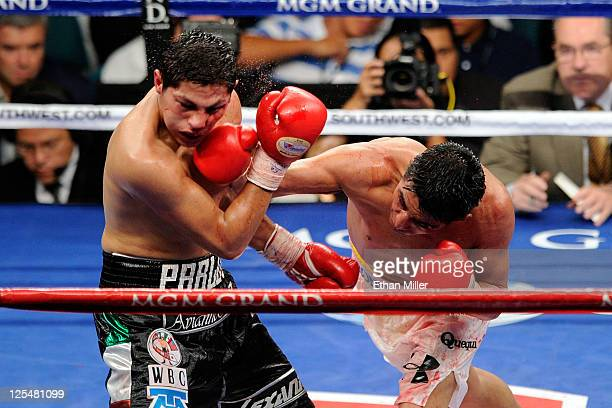 Erik Morales of Mexico connects with a right to the face of Pablo Cesar Cano of Mexico during their WBC super lightweight title fight at the MGM...