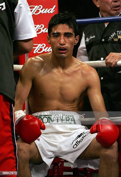 Erik Morales of Mexico sits in his corner before the 10th round of his fight against Manny Pacquiao of the Phillippines during their Super...
