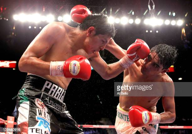 Erik Morales of Mexico throws a right to the head of Pablo Cesar Cano of Mexico during their WBC super lightweight title fight at the MGM Grand...