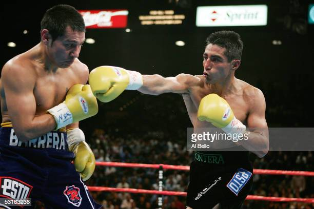 Erik Morales throws a right cross against Marco Antonio Barrera during the WBC World Super Featherweight Championship at the MGM Grand Garden Arena...