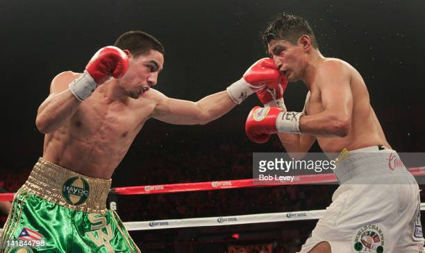 Erik Morales white trunks and Danny Garcia exchange punches during a WBC Super Lightweight Championship at Reliant Arena at Reliant Park on March 24...