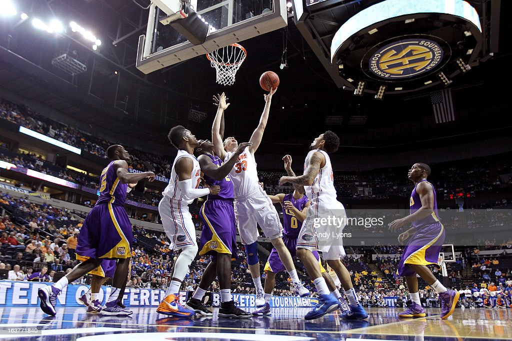 Erik Murphy #33 of the Florida Gators drives to the basket against Johnny O'Bryant III #2 of the LSU Tigers in the first half during the Quarterfinals of the SEC basketball tournament at Bridgestone Arena on March 15, 2013 in Nashville, Tennessee.