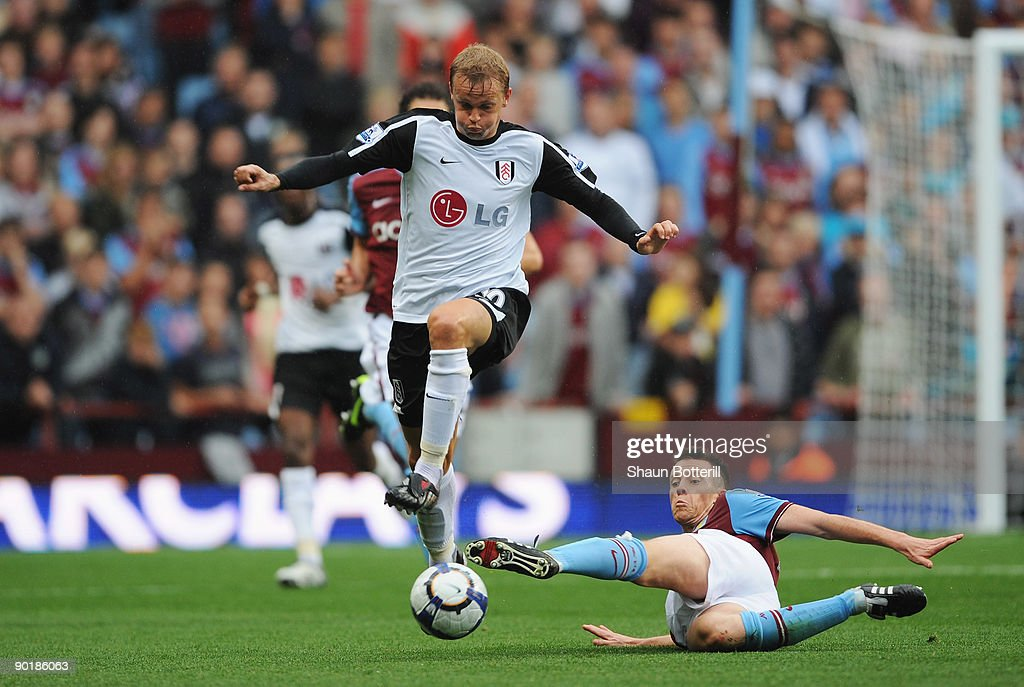 Erik Nevland of Fulham evades a challenge from Nicky Shorey of Aston Villa during the Barclays Premier League match between Aston Villa and Fulham at Villa Park on August 30, 2009 in Birmingham, England.