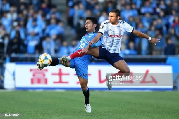 Erik of Yokohama FMarinos and Ryota Oshima of Kawasaki Frontale compete for the ball during the JLeague J1 match between Kawasaki Frontale and...