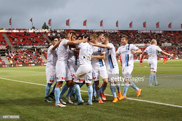 Erik Paartalu of Melbourne City celebrates with teammates after scoring a goal during the round five ALeague match between Adelaide United and...