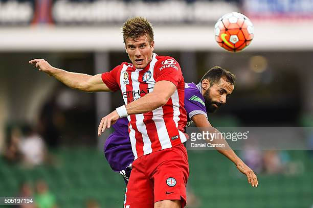 Erik Paartalu of the Melbourne City FC wins a header in front of Diego Castro of the Perth Glory during the round 15 ALeague match between Perth...