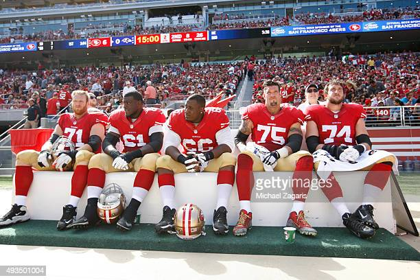 Erik Pears Andrew Tiller Marcus Martin Alex Boone and Joe Staley of the San Francisco 49ers sit on the bench during the game against the Baltimore...