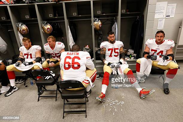 Erik Pears Jordan Devey Marcus Martin Alex Boone and Joe Staley of the San Francisco 49ers relax in the locker room prior to the game against the...
