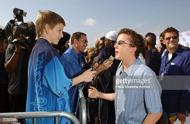 Erik Per Sullivan interviews his Malcom in the Middle costar Frankie Muniz during arrivals at the NIKELODEON 15th ANNUAL KIDS CHOICE AWARDS at Barker...