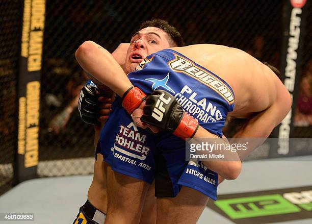 Erik Perez carries Edwin Figueroa in their bantamweight bout during the UFC 167 event inside the MGM Grand Garden Arena on November 16, 2013 in Las...