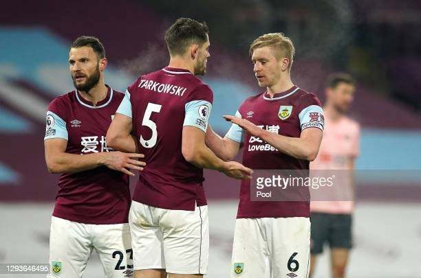 Erik Pieters, James Tarkowski and Ben Mee of Burnley celebrate following their sides victory in the Premier League match between Burnley and...
