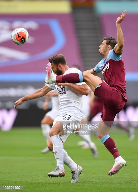 Erik Pieters of Burnley battles for possession with Aaron Cresswell of West Ham United during the Premier League match between West Ham United and...
