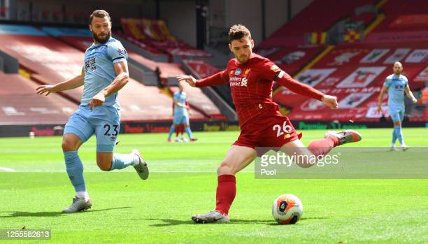 Erik Pieters of Burnley looks to block a shot from Andy Robertson of Liverpool during the Premier League match between Liverpool FC and Burnley FC at...