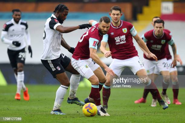 Erik Pieters of Burnley looks to break past Josh Onomah of Fulham during The Emirates FA Cup Fourth Round match between Fulham and Burnley at Craven...
