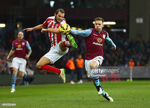 Erik Pieters of Stoke City and Andreas Weimann of Aston Villa battle for the ball during the Barclays Premier League match between Aston Villa and...