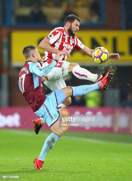 Erik Pieters of Stoke City and Johann Gudmundsson of Burnley during the Premier League match between Burnley and Stoke City at Turf Moor on December...