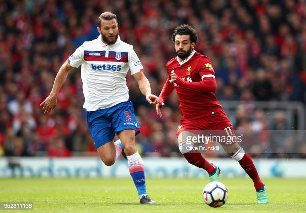 Erik Pieters of Stoke City and Mohamed Salah of Liverpool in action during the Premier League match between Liverpool and Stoke City at Anfield on...