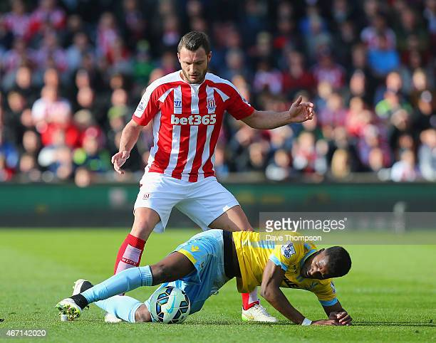 Erik Pieters of Stoke City and Wilfried Zaha of Crystal Palace battle for the ball during the Barclays Premier League match between Stoke City and...