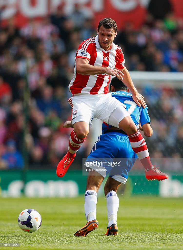 Erik Pieters of Stoke City challenges for the ball with Ahmed Elmohamady of Hull City during the Barclays Premier League match between Stoke City and Hull City at Britannia Stadium on March 29, 2014 in Stoke on Trent, England.