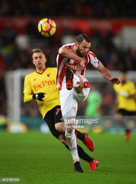 Erik Pieters of Stoke City clears the ball from Gerard Deulofeu of Watford during the Premier League match between Stoke City and Watford at Bet365...