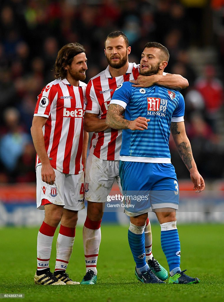 Erik Pieters of Stoke City (C) holds back Jack Wilshere of AFC Bournemouth (R) after he has words with Joe Allen of Stoke City (L) during the Premier League match between Stoke City and AFC Bournemouth at Bet365 Stadium on November 19, 2016 in Stoke on Trent, England.