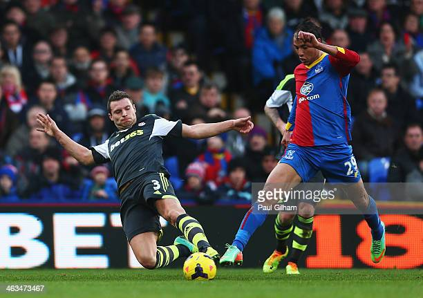 Erik Pieters of Stoke City tackles Marouane Chamakh of Crystal Palace during the Barclays Premier League match between Crystal Palace and Stoke City...