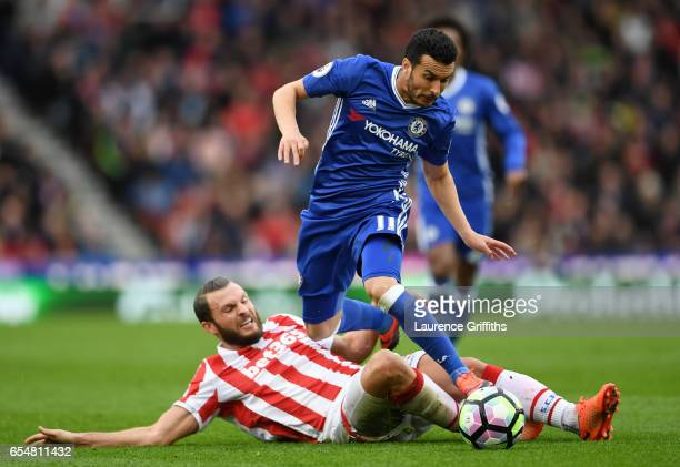 Erik Pieters of Stoke City tackles Pedro of Chelsea during the Premier League match between Stoke City and Chelsea at Bet365 Stadium on March 18 2017...