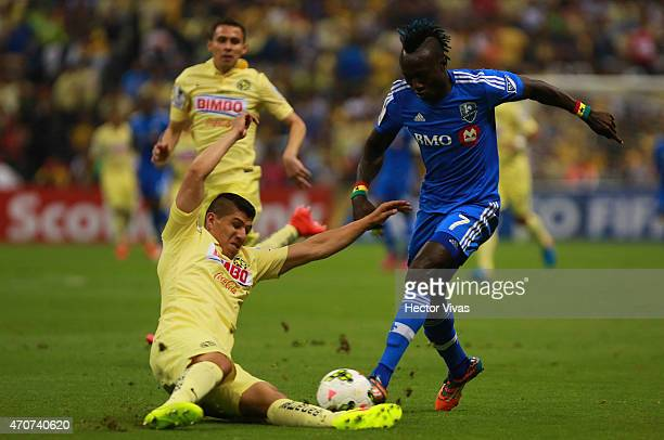 Erik Pimentel of America struggles for the ball with Dominic Oduro of Montreal Impact during a Championship first leg match between America and...