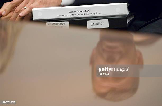 Erik Prince chairman of the Prince Group LLC and Blackwater USA is seen reflected in the witness table holding notebooks as he waits to testify...