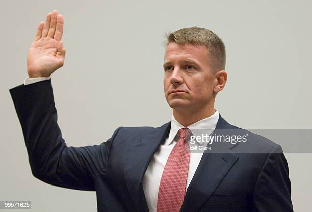 Erik Prince chairman of the Prince Group LLC and Blackwater USA is swornin during the House Oversight and Government Reform Committee hearing on...