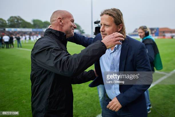 Erik Rasmussen head coach of Vendsyssel FF shake hands for fairplay with Bo Henriksen head coach of AC Horsens prior to the Danish Alka Superliga...