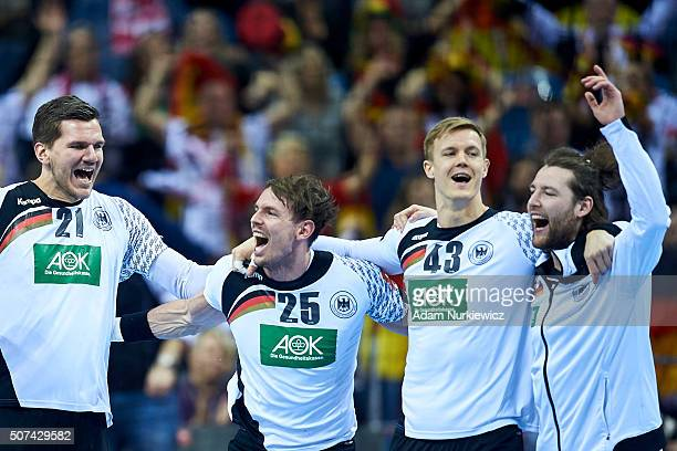 Erik Schmidt Kai Hafner and Niclas Pieczkowski of Germany celebrate with team mates after victory during the Men's EHF Handball European Championship...