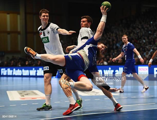 Erik Schmidt of Germany challenges Kari Kristjan Kristjansson of Iceland during the international handball friendly match between Germany and Iceland...