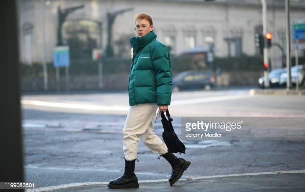Erik Scholz is seen wearing Bottega Veneta boots, Weekday jeans, Jil Sander shirt, Daily Paper jacket and Dior beltbag during Milan Fashion Week...