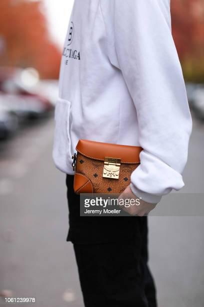 7a67de8e07c8 Erik Scholz wearing a Balenciaga hoodie and a MCM bag on October 28 2018 in  Berlin