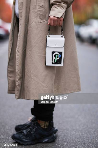 Erik Scholz wearing a Burberry coat Prada mini bag and Balenciaga track shoes on October 28 2018 in Berlin Germany