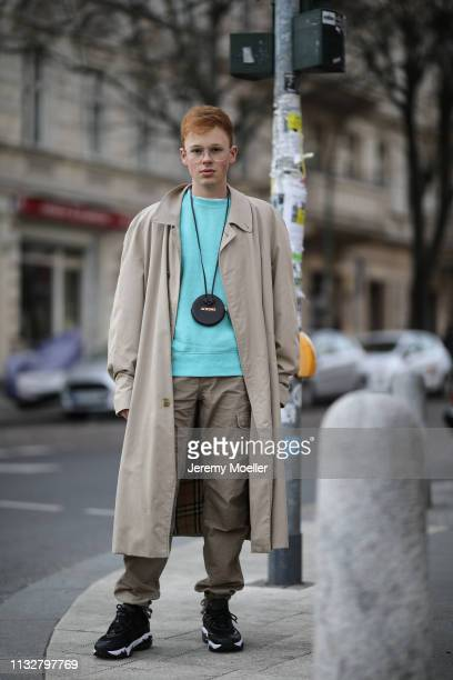 Erik Scholz wearing a Burberry coat Puma shoes Jacquemes bag Carhartt cargo pants and Topman sweater on February 28 2019 in Berlin Germany